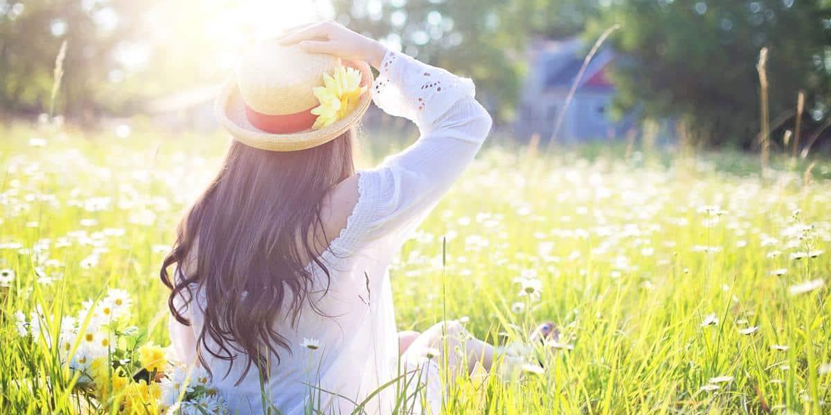 Woman in sunny green field